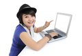 Young woman smiled and pointed to the laptop on white background Royalty Free Stock Images