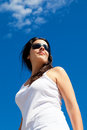 Young woman smiling with a blue sky background bright Stock Photography