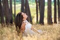 Young woman smiling in a countryside meadow Royalty Free Stock Photo