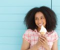 Young woman smiling and eating ice cream