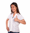 Young woman smiling and showing you ok sign portrait of a charming ethnic against white background Stock Images