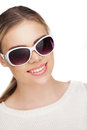 Young woman smokin electic cigarette blond with sunglases studio white Stock Image