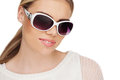 Young woman smokin electic cigarette blond with sunglases studio white Royalty Free Stock Image