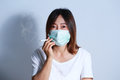 Young woman smoking cigarette with  protective mask Royalty Free Stock Photo