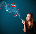 Young woman smoking dangerous cigarette beautiful with no signs Royalty Free Stock Photography