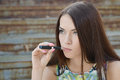 Young woman smoking electronic cigarette e cigarette sexy Stock Photography