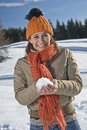 Young woman with snow ball Royalty Free Stock Photography