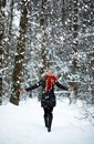Young Woman in snow winter forest happy Royalty Free Stock Image