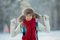 Young woman in a snowy furry hood Royalty Free Stock Photo