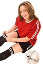 Young woman in soccer uniform Stock Images