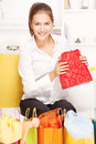 Young woman on sofa with shopping bags Royalty Free Stock Image