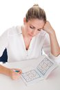 Young Woman Solving Sudoku Royalty Free Stock Photo