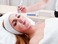 Young woman in spa clinic doing cosmetic procedures Stock Photo