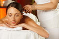 Young woman on spa treatment girl is a she is having with volcanic stones Royalty Free Stock Photography