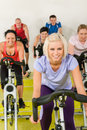 Young woman at spinning class enjoy workout Royalty Free Stock Image