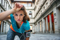 Young woman in sportswear is catching breath Royalty Free Stock Photo
