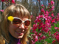 Young woman in spring park beautiful sunglasses with dandelion a Royalty Free Stock Photography