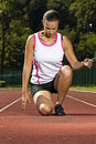 Young woman in sprinting position Stock Photography
