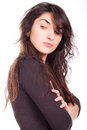 Young woman standing beautiful with arms crossed and looking over the shoulder Royalty Free Stock Images
