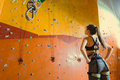 Young woman standing in a climbing gym Royalty Free Stock Photo