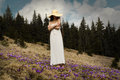 Young woman standing on a flowered hillside in the mountains carpathian flowering crocus time Stock Photos