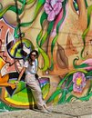 Young woman standing in front of a Grafitti wall Royalty Free Stock Photo