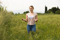 Young woman standing in green field Royalty Free Stock Photo
