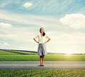 Young woman standing on the road successful and smiling Royalty Free Stock Photo