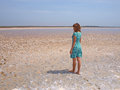 Young woman standing on a salt lake Stock Photo