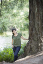 Young Woman Standing by Tree Stock Photography