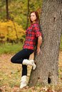 Young Woman standing by a tree Stock Photo