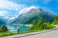 Young woman stands by mountain lake , Austria Royalty Free Stock Photo