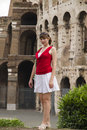 Young woman stands near Coliseum Stock Images