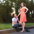 Young woman stands near her boyfriend women with confident look Royalty Free Stock Photography