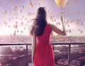 Young woman staring at thousands of the balloons colorful Stock Images