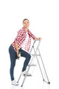 Young woman on step ladder isolated white Stock Photography