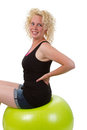 Young woman stretching sitting on a fitness ball isolated Stock Photos