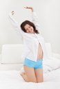 Young woman stretching after waking up Stock Photography