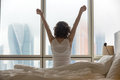 Young woman stretching after waking up Royalty Free Stock Photo