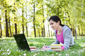Young woman studying in the park Royalty Free Stock Photo
