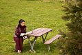 Young Woman Studying at Park with Laptop Royalty Free Stock Photo