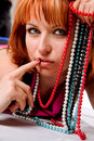 Young woman with stylish hair and beads Stock Photo