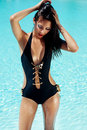 Young woman in the stylish swimsuit Royalty Free Stock Photography