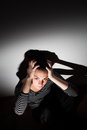 Young woman suffering from a severe depression Royalty Free Stock Photo