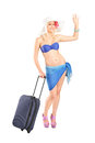 Young woman with suitcase going on a holiday Stock Photos