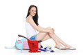 Young woman with suitcase happy sits on a white background vacation Stock Images