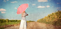 Young woman with suitcase and umbrella Royalty Free Stock Photo