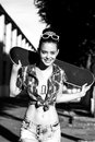 Young woman in summer dress trendy happy girl with skateboard outdoors urban lifestyle shot Stock Image