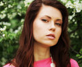 Young woman in summer park wearing pink dress Royalty Free Stock Photography