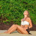 Young woman sunbathe get sunset time outdoor portrait Stock Photography